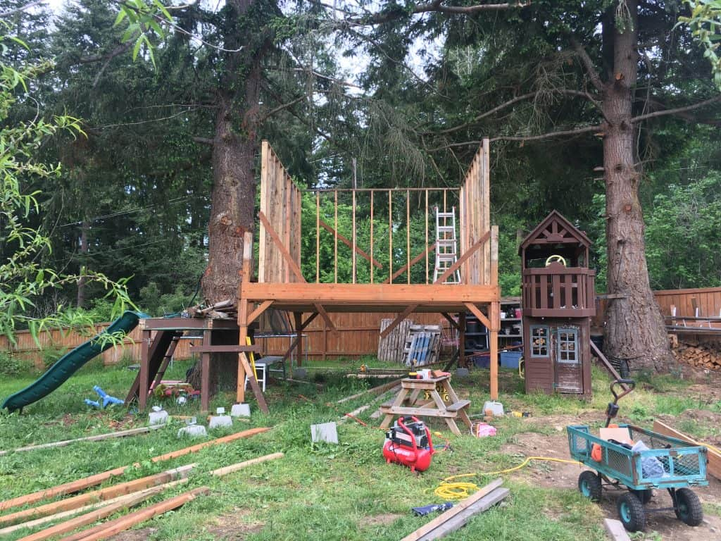 custom treehouse platform and wall framing going up